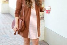 08 a striped over the knee dres,s beige booties, a rust cardigan and a rust saddle bag
