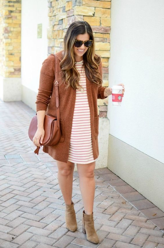 a striped over the knee dres,s beige booties, a rust cardigan and a rust saddle bag