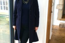 08 black skinnies, a navy top, a blue coat, navy suede heels, a statement necklace and a bold lip