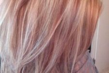 08 blonde medium length hair with strawberry blonde highlights and a slight cascade for a chic look