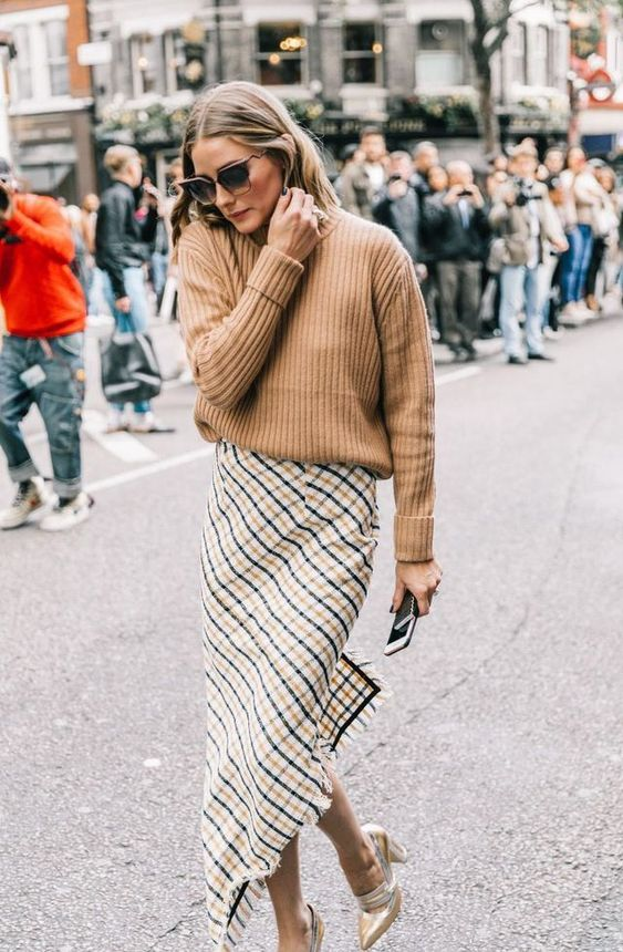 a camel oversized sweater, an asymmetric plaid midi skirt, metallic shoes for a fall outfit