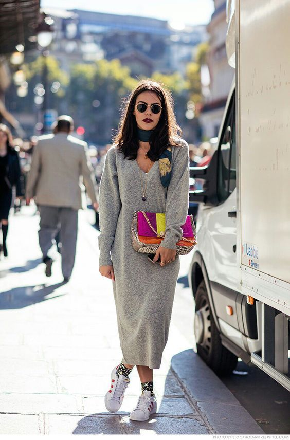 a color block bag, sneakers, a bright scarf and a dark lipstick raise this grey knit dress to a new level