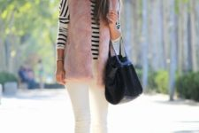 09 a striped long sleeve top, white jeans, a pink faux fur waistcoat, black boots and a bag