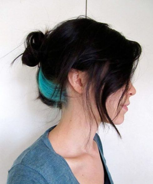 black hair with turquoise peekaboo highlights for a bright look and a colorful touch