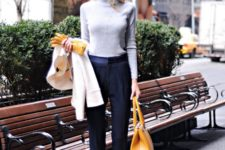 09 black pants, a grey turtleneck, navy heels and a mustard bag for look with bright fall touches