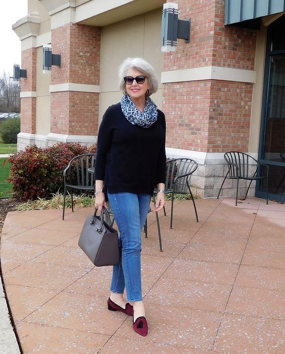 blue cropped jeans, a black sweater, a leopard scarf, burgundy moccasins with tassels and a grey bag