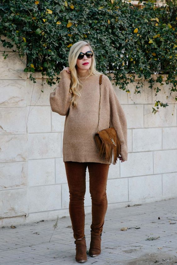 cognac velvet pants, cognac boots, a camel sweater and a cognac bag with fringe