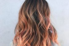 09 dark hair with strawberry blonde balayage is a contrasting and bold idea, add waves for a texture