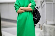 10 a bold green knit midi dress with a high neckline, black booties and a bag to make a statement