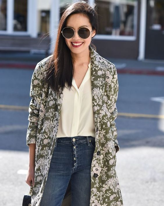 a green and white floral coat will add a touch of color and a print to your look