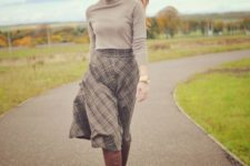 10 a grey turtleneck, a grey plaid A-line midi skirt, brown boots for a retro-inspired fall look