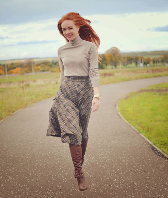 a grey turtleneck, a grey plaid A-line midi skirt, brown boots for a retro-inspired fall look