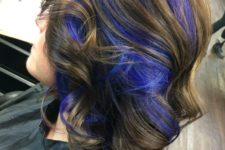 10 chestnut wavy hair with purple peekaboo highlights for a super bold look