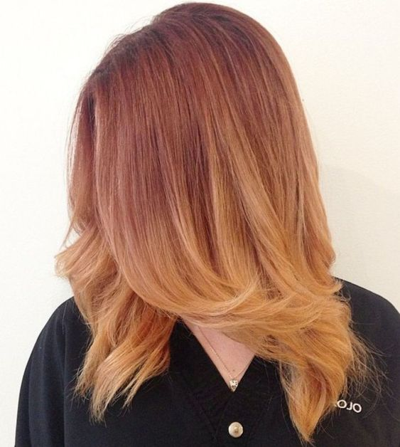 ombre auburn strawberry blonde hair with a cascade for a bright and cool look