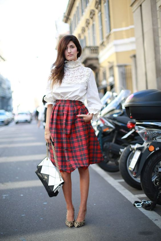 a holiday-colored knee A-line skirt, leopard print shoes, a vintage high neck blouse and a geometric bag