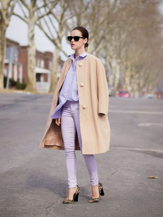 a lavender look with pants and an oversized shirt, a camel coat and leopard heels to look bold