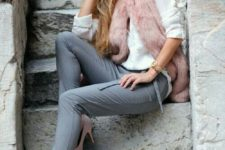 11 a white long sleeve tee, grey pants, nude heels and a pink faux fur vest for a bright look