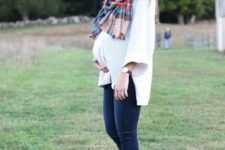 11 a white sweater, navy skinnies, brown booties, a plaid scarf and a hat for a comfy fall look
