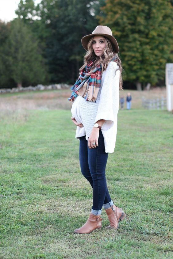 a white sweater, navy skinnies, brown booties, a plaid scarf and a hat for a comfy fall look