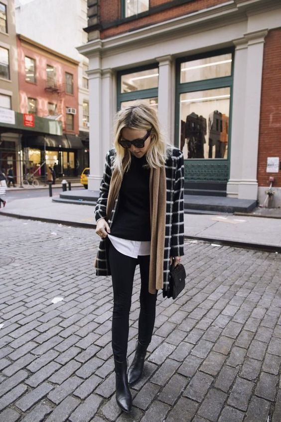 black skinnies plus boots, a white shirt, a black sweater, a plaid coat and a neutral scarf