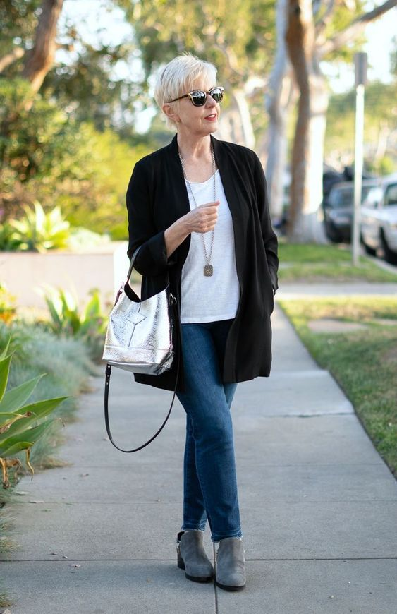 blue jeans, a white tee, grey boots, a black cardigan, a silver bag and a necklace