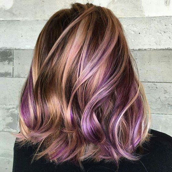 copper hair with rose gold balayage and purple peekaboo highlights that make the look rock