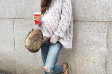11 distressed denim, an oversized chunky knit sweater, studded flats and a hat for winter