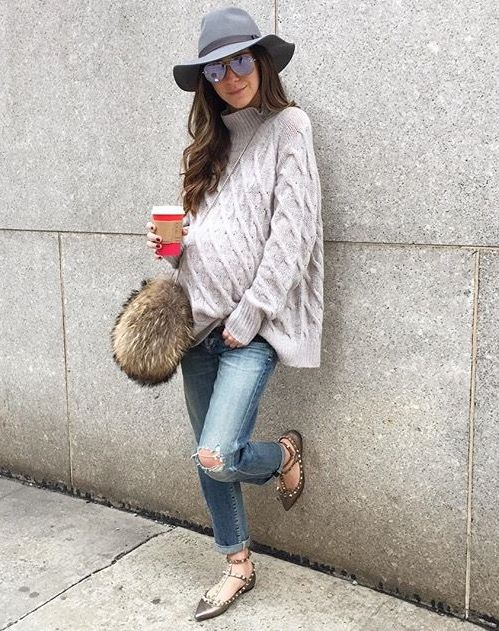 distressed denim, an oversized chunky knit sweater, studded flats and a hat for winter