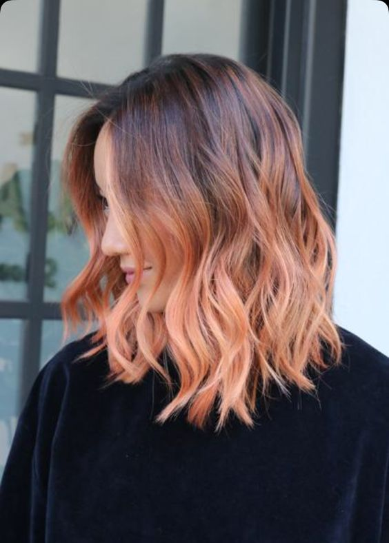 ombre wavy hair from burgundy chestnut to strawberry blonde is a bright statement