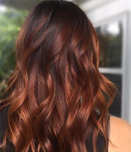 red brown hair with a lighter balayage is a gorgeous idea, especially with waves that are in trend