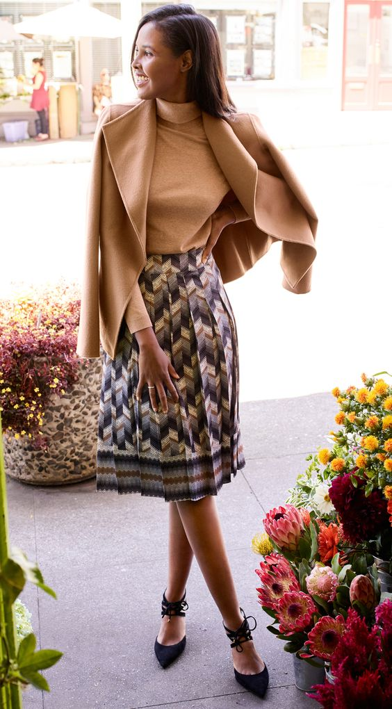 a chic fall work look with a printed pleated knee skirt, a nude turtleneck, a camel short coat and lace up shoes