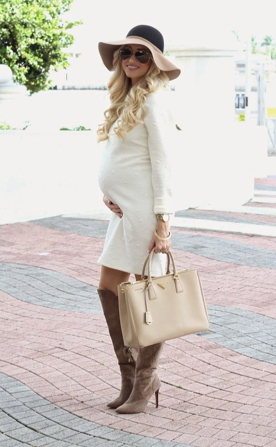 a creamy over the knee dress, tall brown boots,  a beige bag and a hat for the fall