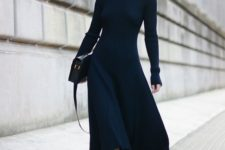 12 a fitting black midi sweater dress with a high neckline by Celine, black boots and a bag for a wow look