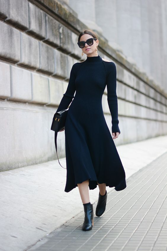 a fitting black midi sweater dress with a high neckline by Celine, black boots and a bag for a wow look