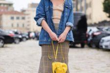 12 a neutral top, a plaid midi skirt, black sock boots, a denim jacket and a bright yellow bag