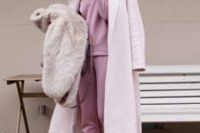 12 a pink suit with a sweatshirt, white platform shoes, a blush coat and a faux fur waistcoat