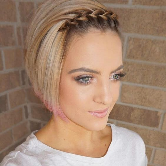a short bob with pink ends and a small French braid on the front for an edgy touch