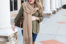 12 an olive green blouse, blue skinnies, tall rust boots, a beige scarf and a large bag