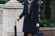 12 black skinnies, a grey cowl sweater, black booties, a navy coat with gold buttons and a black bag