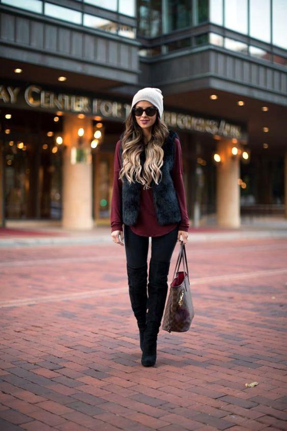 black skinnies, tall boots, a black fur waistcoat, a burgundy shirt and a grey beanie