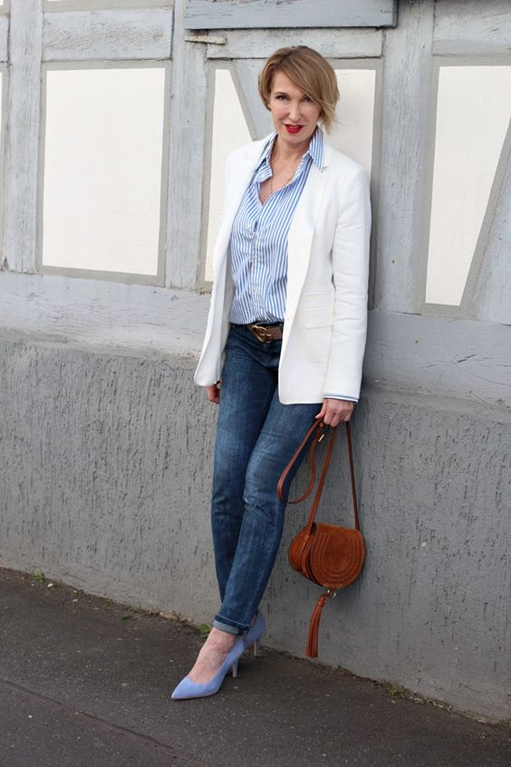 blue skinnies, a striped shirt, a creamy blazer, blue shoes and a little brown bag