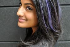 12 long black hair with purple peekaboo highlights that make a colorful statement