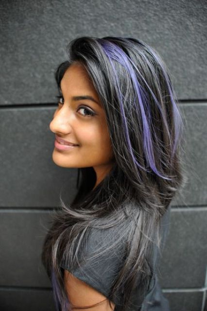 long black hair with purple peekaboo highlights that make a colorful statement