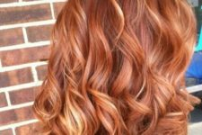 12 red wavy hair with strawberry blonde highlights is a chic and bright idea for standing out