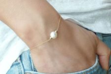 12 rock denim, a teee and a bracelet with a single pearl for an effrtlessly chic look