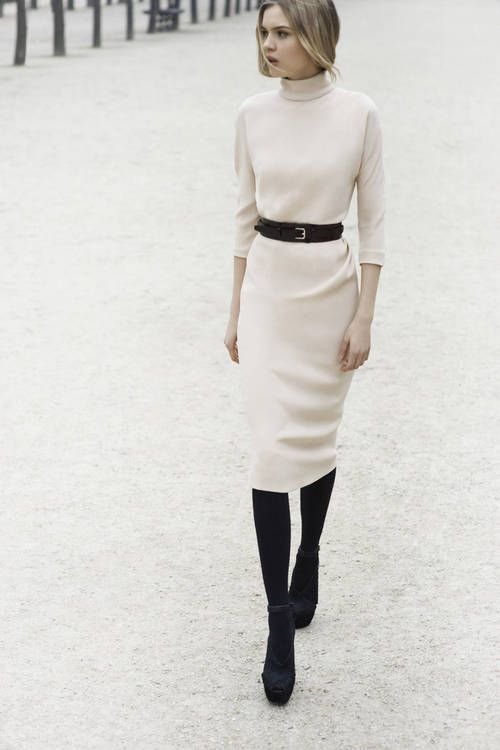 a contrasting look with a white pencil skirt and a turtleneck, black tights, shoes and a belt