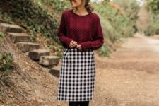 13 a plum-colored sweater, a plaid skirt, black tights and black rubber boots for outdoor walks