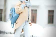 13 a powder blue sweater and pants, a light yellow coat, a powder blue scarf and beanie, a blue backpack