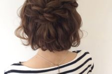 13 a short curly bob with two double braids on top looks very relaxed and cute