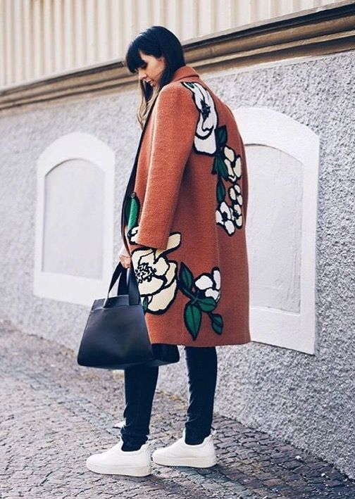 a warm and comfy coat with floral appliques for a trendy modern fall or winter look